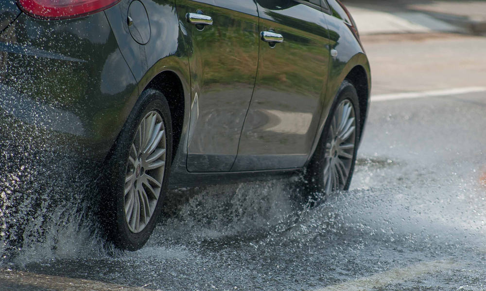Why Vehicles Lose Traction on Wet Tarmac