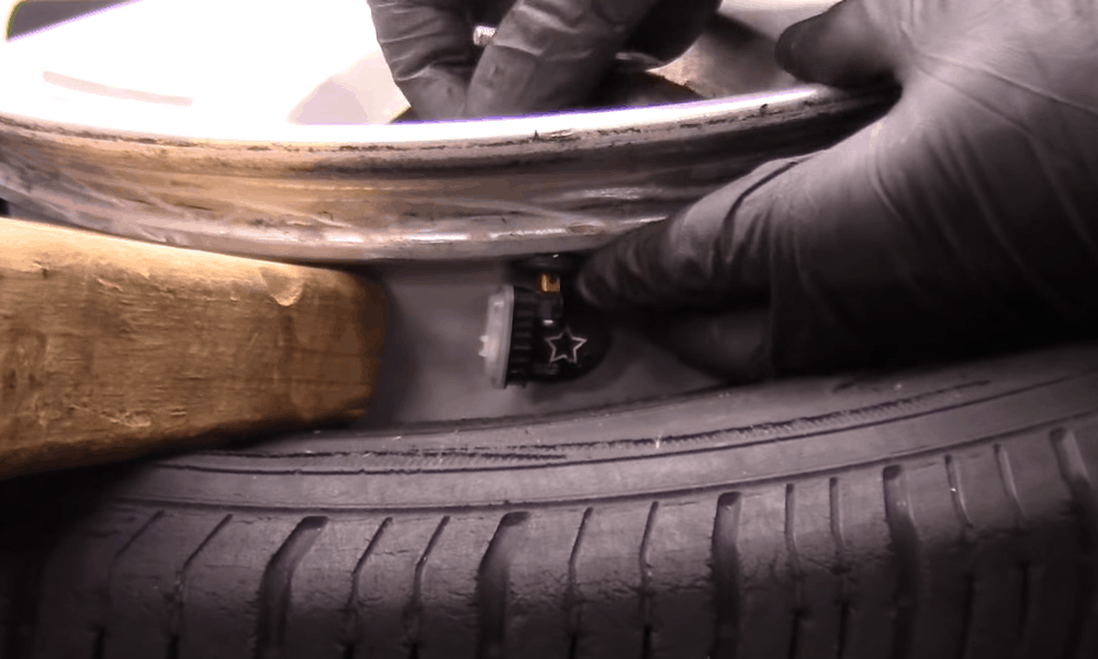 Screw-in the New Valve and TPMS Sensor