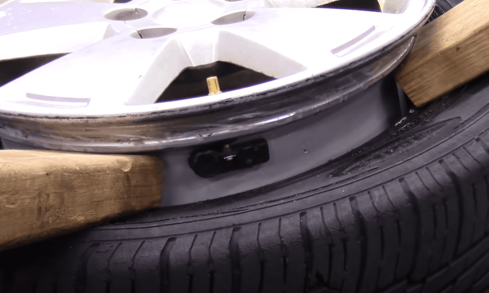Unscrew the Old Valve and TPMS Sensor