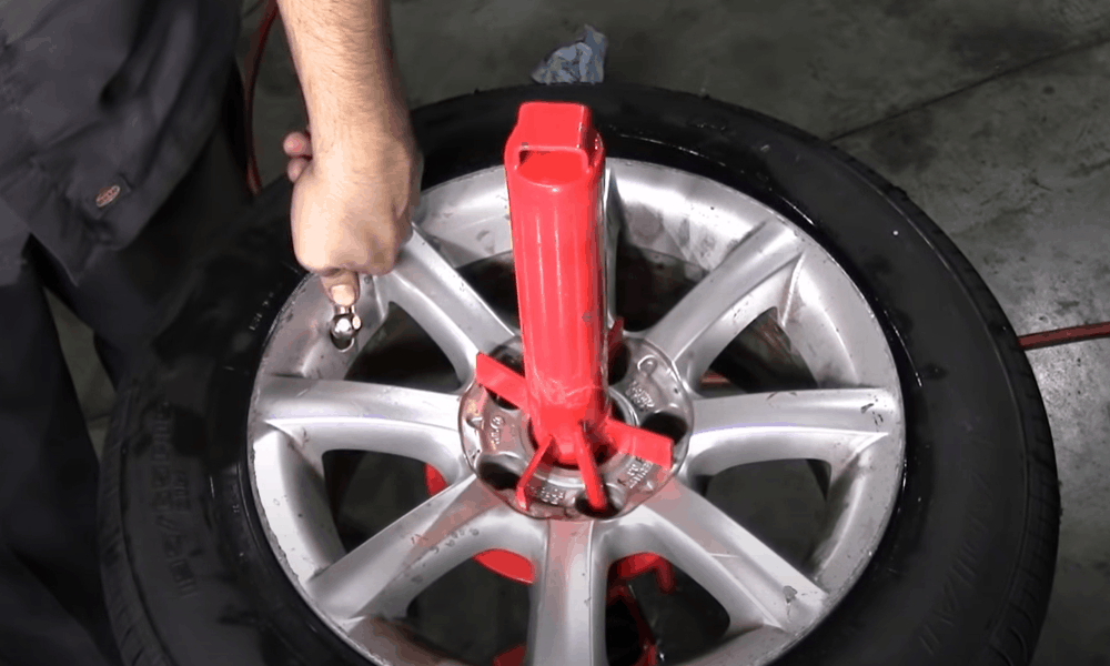 Apply pressure on the tire and fill it with air