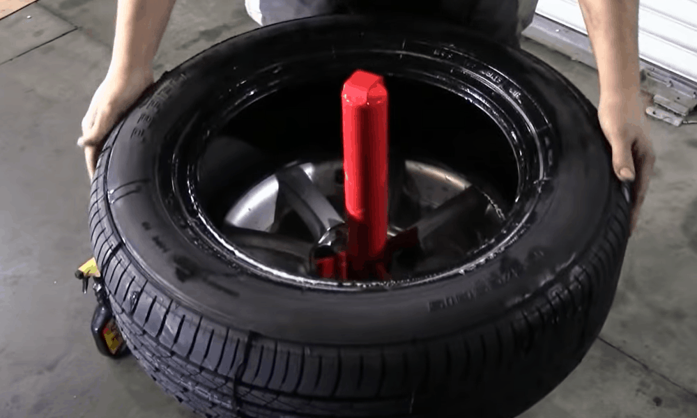 Put the tire on the rim